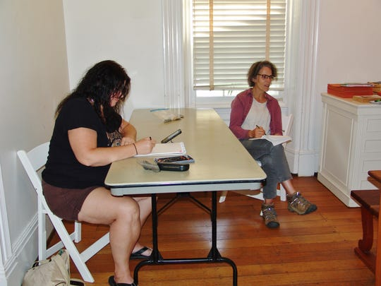 Carole Hunt and Anne Cornell draw together during Open Drawing Night at the Pomerene Center.