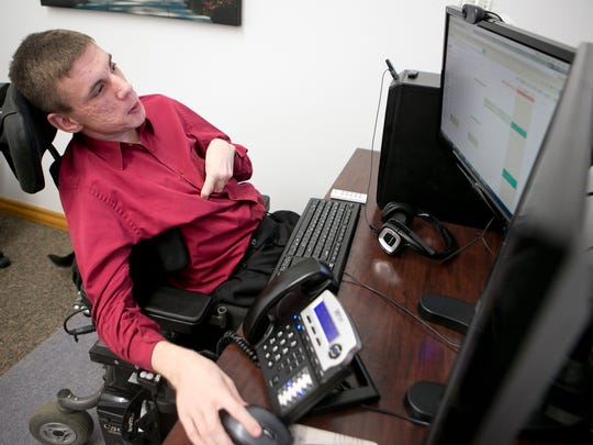 Andy Thain, founder and chairman of At Home Care, works on his computer in his office in Thorp.