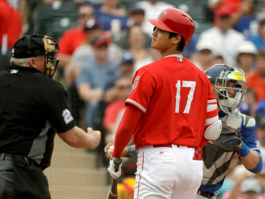 Los Angeles Angels' Shohei Ohtani, of Japan, reacts after striking out against the Los Angeles Dodgers during the third inning of a spring baseball game in Tempe, Ariz., Wednesday, March 7, 2018. (AP Photo/Chris Carlson)