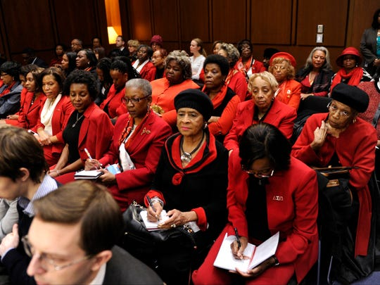 The ladies in red at the confirmation hearing for attorney