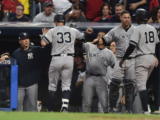 New York Yankees first baseman Greg Bird (33) is congratulated after hitting a two-run home run against the Cleveland Indians during the fifth inning in game two of the 2017 ALDS at Progressive Field on Friday, Oct. 6, 2017.