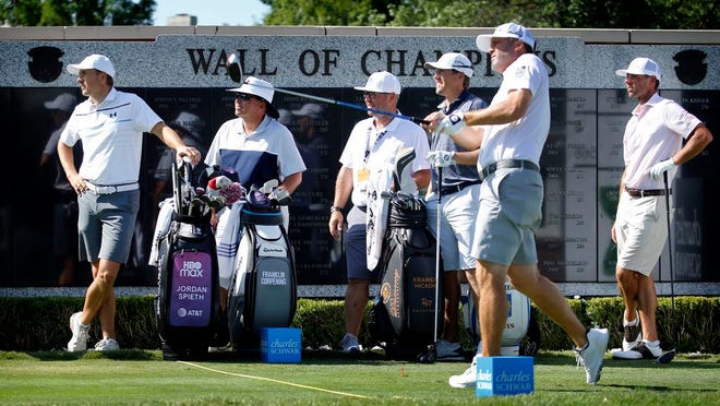 Jordan Spieth, left, watches Ryan Palmer tee off the first hole during practice for the Charles Schwab Challenge golf tournament at the Colonial Country Club in Fort Worth, Texas, Tuesday, June 9, 2020. The Challenge is the first PGA tour event since the COVID-19 pandemic began.