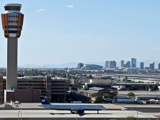Phoenix police say they have arrested a man for sneaking onto the tarmac at Sky Harbor International Airport and triggering the escape slide on a plane.