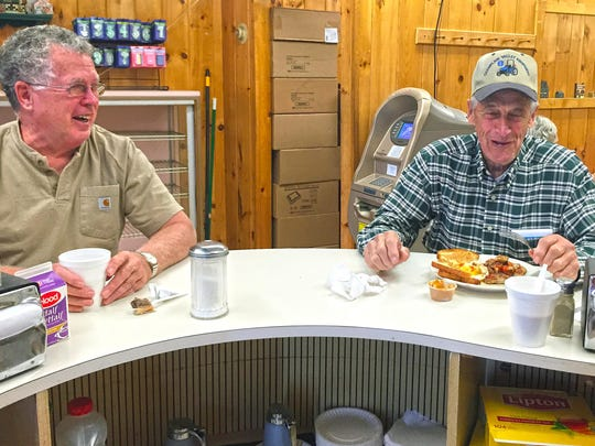 Quality Bake Shop in Essex Junction is a hotspot for regulars who meet for breakfast and chit-chat. Donald Tucker of Westford, left, is seen eating his daily breakfast of eggs, homefries, toast and sausage.