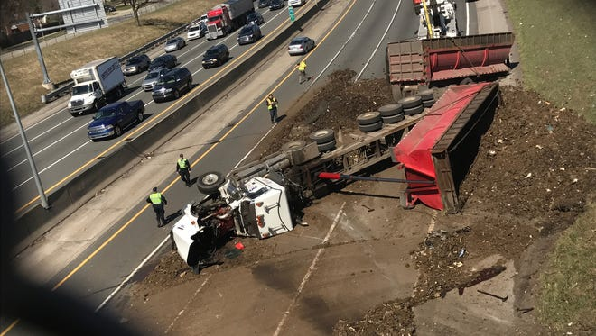 Crews work to clear the scene where a semi overturned on Northbound I-75 between 8 Mile and 9 Mile on Wednesday March 29, 2017.