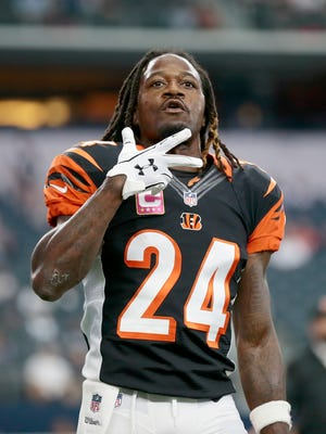 Cincinnati Bengals cornerback Adam Jones (24) talks with fans in the crowd during warm-ups before the NFL Week 5 game between the Dallas Cowboys and the Cincinnati Bengals at AT&T Stadium in Dallas on Sunday, Oct. 9, 2016.