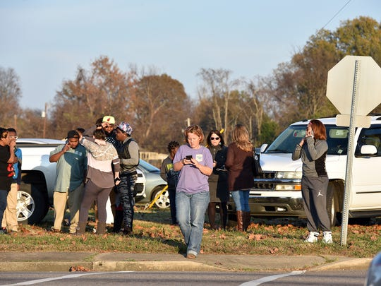Parents wait for their children to be released in this December 2015 file photo after a bomb threat at Warren Central Junior High in Vicksburg. A suspected explosive device was found at the school and rendered safe by Clinton Police Department's bomb squad and an FBI bomb technician.