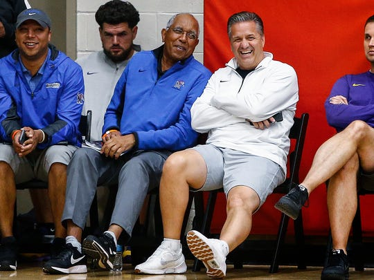 Memphis coach Tubby Smith (middle left) jokes with Kentucky coach John Calipari (middle right) during Team Penny's game at the 2017 Nike Peach Jam in North Augusta, S.C.