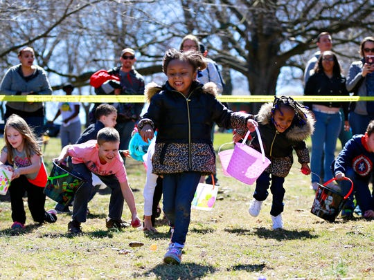 Zhy'onnia Gibson, 5, front, is followed by Ashiya Chester,