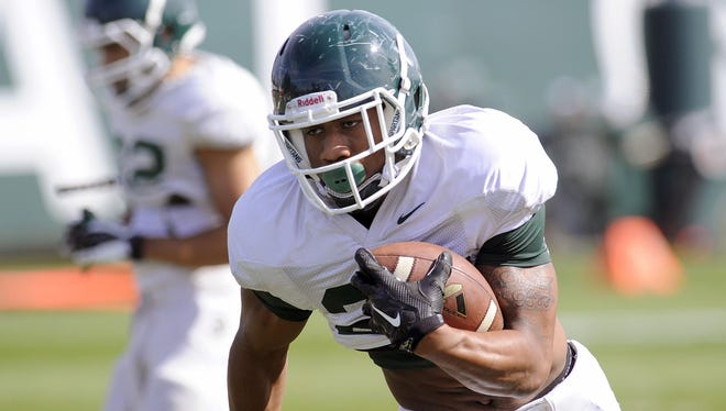 Madre London has emerged from fall camp as the Spartans' first-string tailback. That competition, however, is likely to continue well into the season.