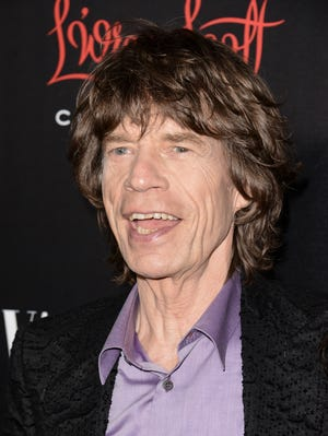 Singer Mick Jagger arrives at the Banana Republic L'Wren Scott Collection launch party at the Chateau Marmont on Tuesday, Nov. 19, 2013 in West Hollywood, Calif.