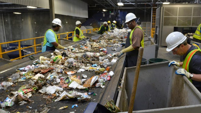 Line sorters at work during a visit t the IREP Materials Recovery Facility on June 11, 2014.