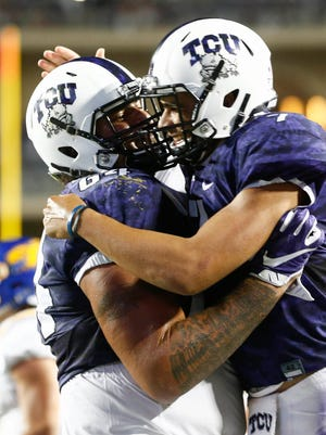 TCU quarterback Kenny Hill (left, celebrating with teammate Matt Pryor) has thrown for over 3,000 yards in his first season as  the Horned Frogs starter.