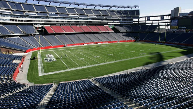Empty seats surround the playing field at Gillette Stadium. Whether the venue will be filled with fans to watch Patriots and Revolution games this summer and fall is a big question mark due to the ongoing COVID-19 pandemic.