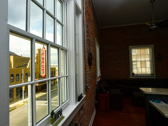 The Wertman family enjoys a picture-postcard view of the Palace Theatre from the front window of their loft apartment at Flyingfish Lofts in downtown Marion.