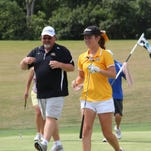 Kristen Smith celebrates with father Keith Smith after she won the amateur title on the first hole of sudden death in 2012.