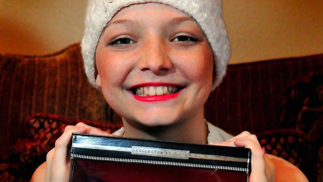 Julie Spurlock age 14, of Merritt Island, Fla., and her  custom-made, hairless Barbie doll.  Julie is suffering from acute lymphoblastic leukemia.