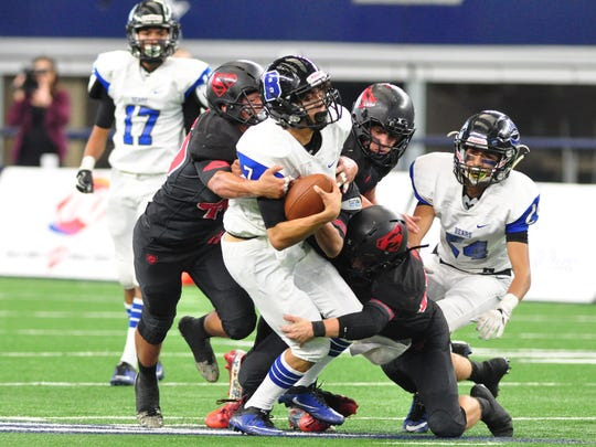 Balmorhea quarterback Marco Martinez is tackled in