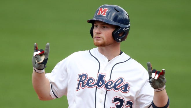 Designated hitter Michael Fitzsimmons poses after getting a hit in a recent game. The redshirt freshman has become a potent bat in Ole Miss' lineup.