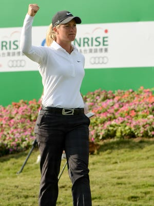 Suzann Pettersen of Norway fires off a fist pump on her way to victory Sunday in the Sunrise LPGA Taiwan Championship.