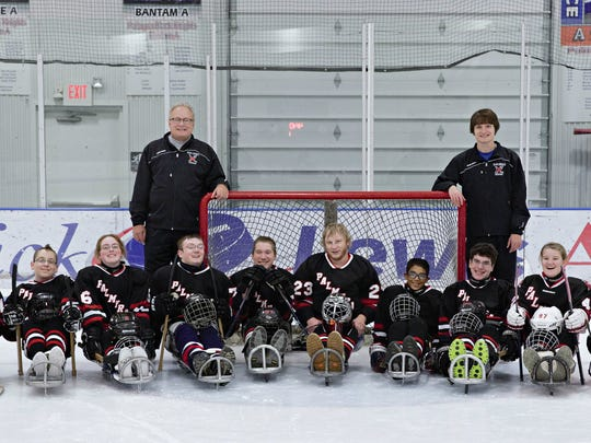 The Palmyra Black Knights sled hockey team has been