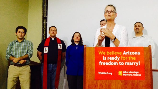The Rev. Debra Peevey addresses a group in support of marriage equality. In background are Jeremy Zegas, project director for Why Marriage Matters Arizona, Pastor Stephen Govett of Asbury United Methodist Church, Minister Susan Frederick-Gray of the Unitarian Universalist Congregation of Phoenix, Dean Troy Mendez of Trinity Episcopal Cathedral, and Rabbi Dean Shapiro of Temple Emanuel.
