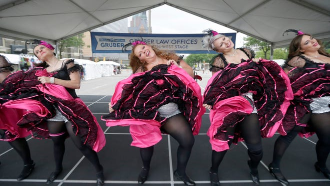 Dancers with Madame Gigi's Outrageous French Cancan Dancers perform at Milwaukee's Bastille Days festival  in 2017.