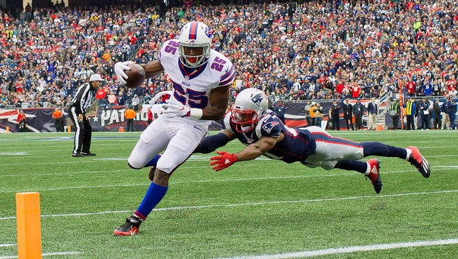Buffalo Bills running back LeSean McCoy (25) gets past New England Patriots cornerback Malcolm Butler (21) for a touchdown during the first quarter at Gillette Stadium. It was the lone touchdown of the game.