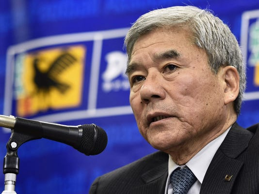 Japan Football Association President Kuniya Daini speaks during a news conference at the JFA headquarters in Tokyo Tuesday, Feb. 3, 2015. Japan coach Javier Aguirre was fired on Tuesday over concerns that allegations of his involvement in match-fixing will interfere with qualifying for the 2018 World Cup. Aguirre agreed it was unavoidable, Daini said at the news conference. (AP Photo/Kyodo News) JAPAN OUT, CREDIT MANDATORY