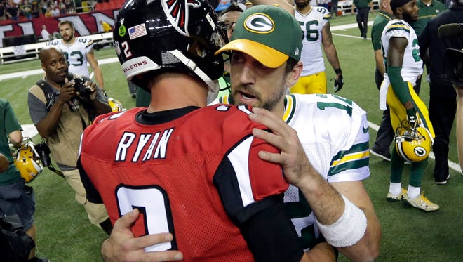 Green Bay Packers quarterback Aaron Rodgers (12) talks with Atlanta Falcons quarterback Matt Ryan (2) after the Green Bay Packers 33-32 loss to the Atlanta Falcons, Sunday, October 30, 2016 at the Georgia Dome in Atlanta Georgia.