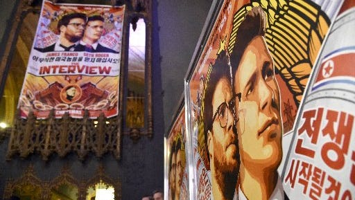 """Sony has pulled the plug on the Christmas Day opening of """"The Interview"""" following hacker threats Dec. 17, 2014. Advertisements for the file are shown at the Theatre at Ace Hotel Downtown LA on Dec. 11, 2014, in Los Angeles."""