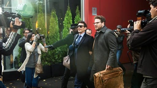 """This photo provided by Columbia Pictures - Sony shows, James Franco, center left, as Dave, and Seth Rogen as Aaron, in Columbia Pictures' """"The Interview."""" (AP Photo/Columbia Pictures - Sony, Ed Araquel)"""