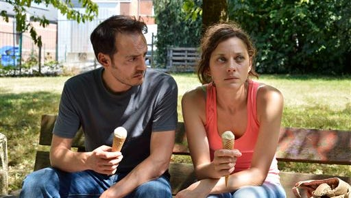 """This photo released by Sundance Selects shows Marion Cotillard, right, as Sandra and Fabio Rongione, her husband Manu, in a scene from the film, """"Two Days, One Night,"""" written and directed by Belgian filmmakers, Jean-Pierre and Luc Dardenne. (AP Photo/Sundance Selects)"""