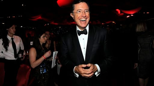 FILE - This Sept. 23, 2012 file photo shows TV personality Stephen Colbert at the 64th Primetime Emmy Awards Governors Ball in Los Angeles.