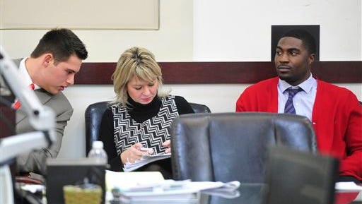 Former Vanderbilt football players Brandon Vandenberg, left, and Cory Batey, right, attend the second day of their trial Tuesday, Jan. 13, 2015, in Nashville, Tenn. Vandenburg and Batey are being tried on five counts of aggravated rape and two counts of aggravated sexual battery. Vandenburg is also charged with one count of tampering with evidence and one count of unlawful photography. (AP Photo/The Tennessean, Samuel M. Simpkins)