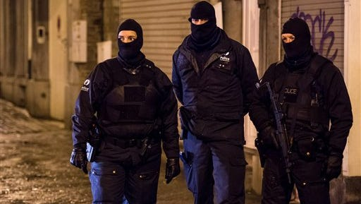 Belgian police guard a street in Verviers on Thursday, Jan. 15, 2015. Authorities said two people were killed and one was arrested during a shootout in an anti-terrorist operation.