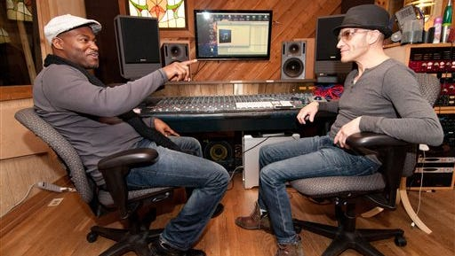 In this recent photo, Tullahoma, Tenn., native Tyronn Hamilton, left, talks with percussionist/producer Pino Squillace at the Creative Caffeine Music Studio in Nashville, Tenn. It would seem that Hamilton was almost destined to become a musician, growing up in Tullahoma in a house full of musicians that included his parents Walter and Donna Hamilton and his 10 siblings.