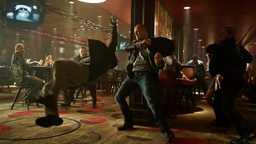"""This photo released by Lionsgate shows, Jason Statham, center, as Nick Wild in a scene from the film, """"Wild Card."""" (AP Photo/Lionsgate)"""