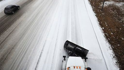 A Tennessee Department of Transportation salt truck works along I-65 at Armory Drive in Nashville on Feb. 16.