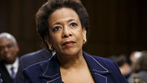 Attorney general nominee Loretta Lynch appears on Capitol Hill in Washington. A vote on her nomination was tabled until  lawmakers resolve their dispute over a human trafficking bill containing a controversial abortion provision.