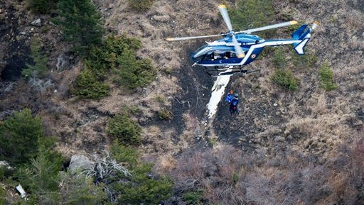 This photo provided by the Gendarmerie Nationale shows rescue workers being rappelled from an helicopter on the crash site near Seyne-les-Alpes, French Alps, Wednesday, March 25, 2015.  French investigators cracked open the badly damaged black box of the Germanwings plane on Wednesday and sealed off the rugged Alpine crash site where 150 people died when their plane on a flight from Barcelona, Spain to Duesseldorf, Germany, slammed into a mountain Tuesday.  (AP Photo/Fabrice Balsamo, Gendarmerie Nationale)