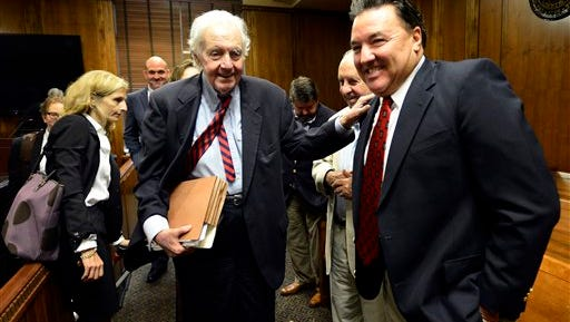 John Jay Hooker, center, is greeted as he leaves the courtroom after his hearing on Friday, July 10, 2015, in Nashville, Tenn. The 84-year-old Nashville attorney, businessman and political candidate has filed a suit in Davidson County Chancery Court against a law that makes it a felony for a doctor or another person to assist in someone's death. Hooker has terminal Stage IV cancer. (AP Photo/Mark Zaleski)