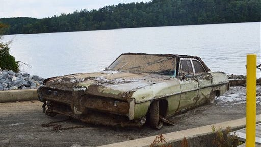 A 1968 Pontiac Catalina that was pulled from Lake Rhodhiss on Tuesday contained remains that are believed to be those of Amos Shook. Shook was reported missing in 1972, and his case remained unsolved until investigators searched the lake with sonar at the family's request.