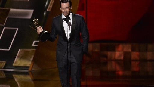 "Jon Hamm accepts the Emmy for best actor in a drama series for his work on ""Mad Men."""