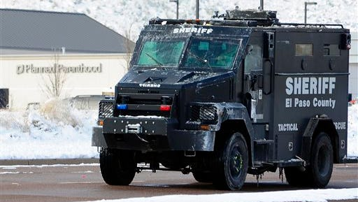 An El Paso County Sheriff's tactical response vehicle leaves the scene on Sunday, Nov. 29, 2015, in Colorado Springs, Colo., after Friday's deadly shooting at a Planned Parenthood clinic. (Daniel Owen/The Gazette via AP) MAGS OUT; MANDATORY CREDIT