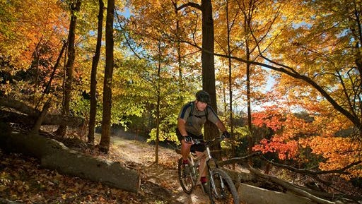 FILE - In this Oct. 22, 2010 file photo, Jared Veronick rides the White Tail Loop bike trail at Warriors Path State Park in Kingsport , Tenn. The park is among 11 for which Gov. Bill Haslam sought to outsource operations, but his administration announced on Monday, Dec. 14, 2015, that it had received no bids from private vendors.