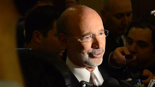 Gov. Tom Wolf responds reporters' questions after speaking at a Pennsylvania Press Club luncheon  Monday, Nov. 23, 2015 in Harrisburg, Pa. Wolf urged Republican lawmakers to support a proposed deal to swap a state sales tax increase for $1.4 billion in school property tax cuts for homeowners . Republicans say they disagree with Wolf over which school districts should benefit most from the rebates.