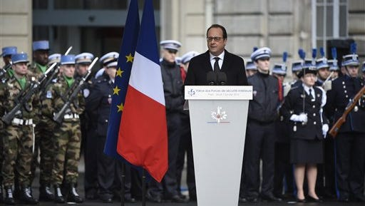 """President Francois Hollande delivers his New Year's speech to police forces charged with protecting the country against new attacks, at the Paris's police headquarters Thursday one year after the attack targeting the French satirical newspaper Charlie Hebdo. Hollande said what he calls a """"terrorist threat"""" will continue to weigh on the country, which was struck a year ago by Islamic extremists"""