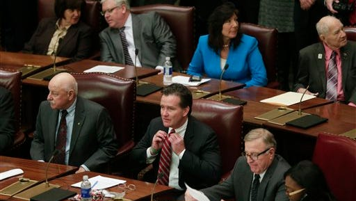 Senate Majority Leader John Flanagan, R-Smithtown, adjusts his tie in the Senate Chamber at the Capitol on the opening day of the legislative session on Wednesday, Jan. 6, 2016, in Albany, N.Y. (AP Photo/Mike Groll)