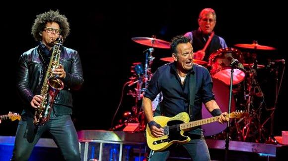 Bruce Springsteen, center, Max Weinberg, and Jake Clemons,